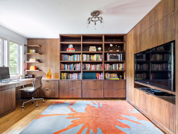 Home Office With Built-In Bookshelves and Television Insert