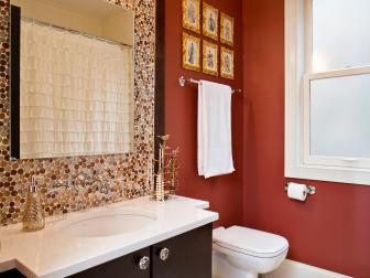 Rust Orange Bathroom Features Dotted Mosaic Tile Backsplash