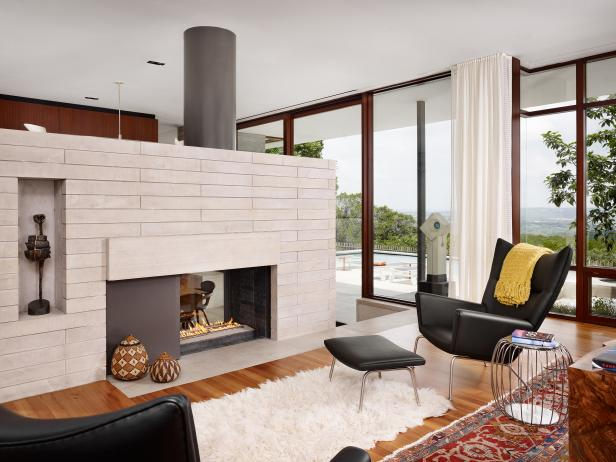 Cozy Midcentury Modern Living Room With Two-Sided Fireplace