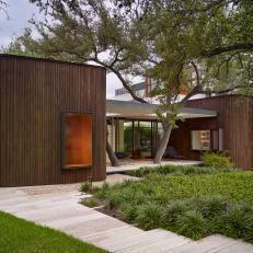 Striking Midcentury Modern Home With Limestone Walkway