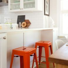 Bright Red Stools Give Warmth to Space