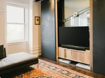 Modern Entertainment Center With Sliding Steel Doors