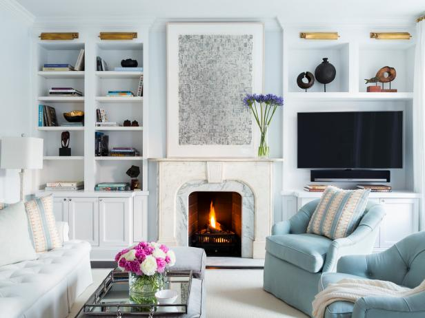 Cool Blue Living Room With Marble Fireplace