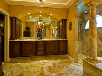 Grand Tuscan-Style Bathroom With Large Wood Vanity