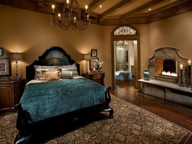 Elegant Mediterranean Bedroom With Cast Stone Fireplace