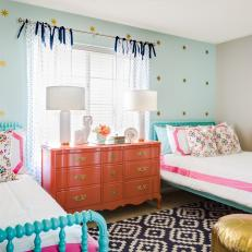 Shared Girl's Room With Aqua Accent Wall and Coral Dresser