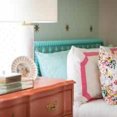 Colorful Girl's Bedroom With Coral Dresser and Aqua Bed Frame
