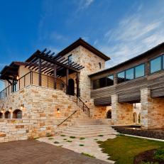 Mediterranean Home Exterior With Contemporary Flair
