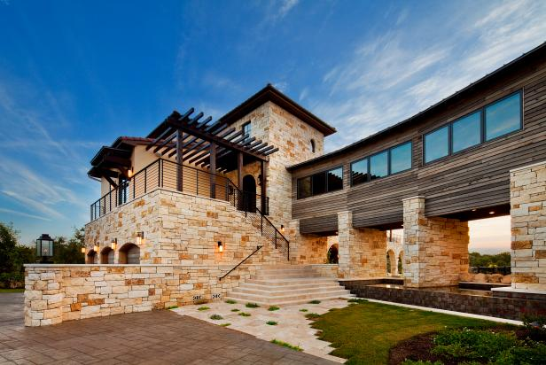 Mediterranean home exterior with contemporary flair hgtv for Flair custom homes