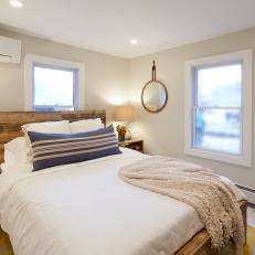 Bright Warm Master Bedroom with Natural Material Accents