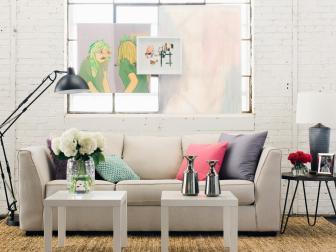 Feminine Living Room With Art Hanging in Windows