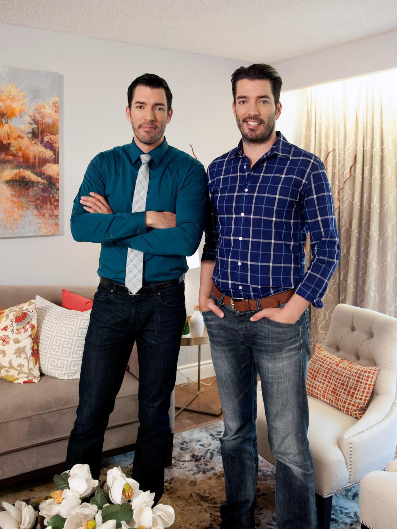 Drew and scott pose in renovated living room hosts drew Who are the property brothers