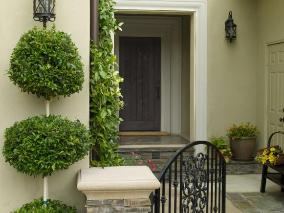 Mediterranean-Style Home With Wrought-Iron Gate