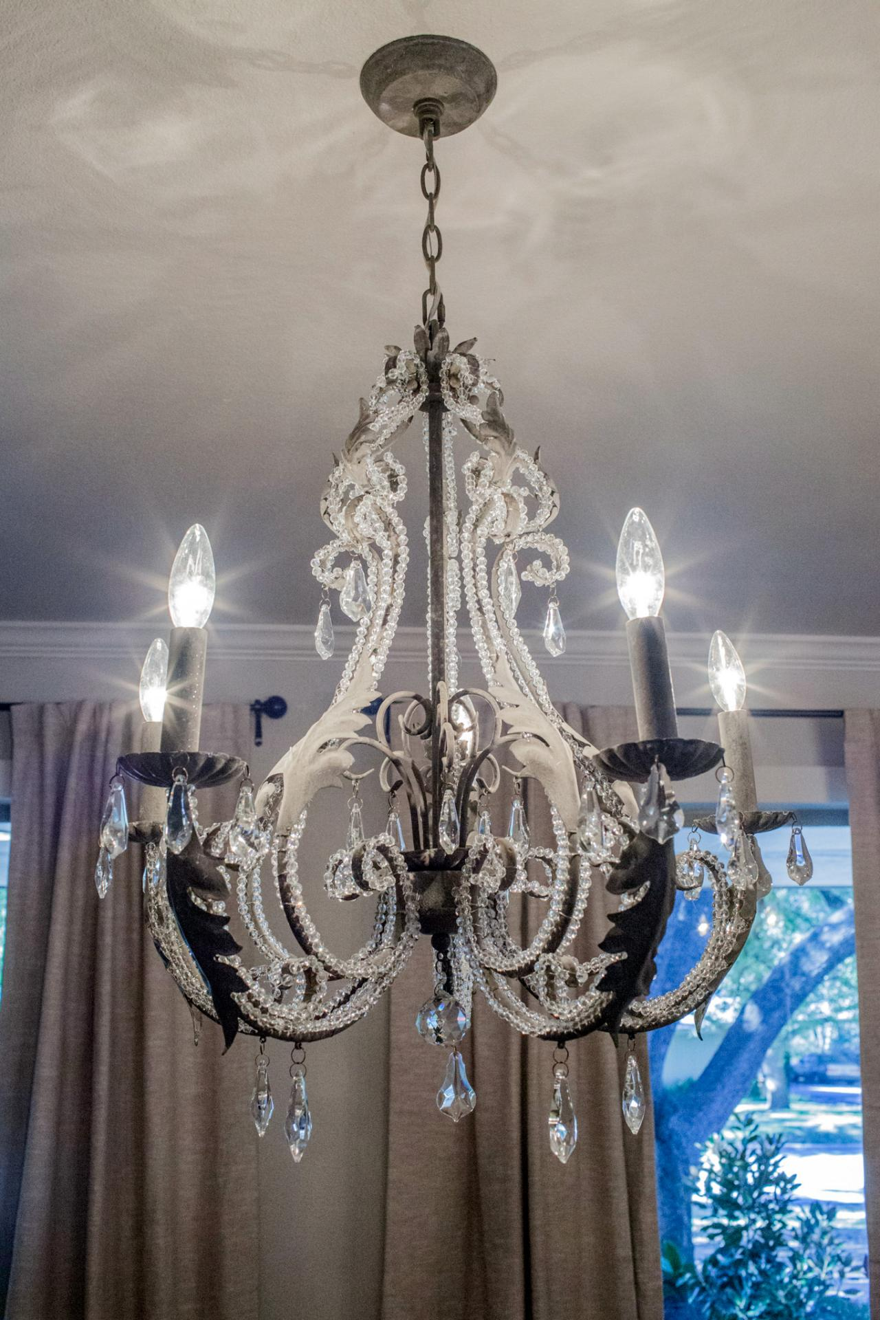 fixer upper elegant chandelier in remodeled dining room hgtv