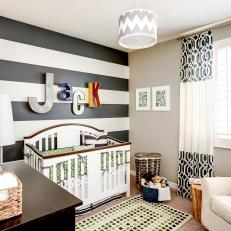 Transitional Boy's Nursery With Black and White Striped Accent Wall