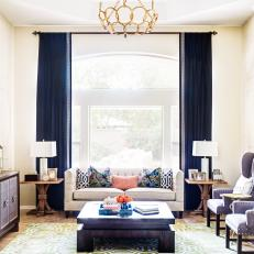 Neutral Transitional Living Room With Blue Curtains