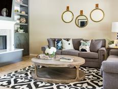 Neutral Transitional Living Room With Round Mirrors