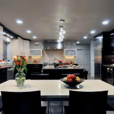 Contemporary Kitchen Features Black and White Cabinets