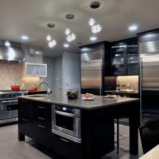 Contemporary Kitchen With Dark Cabinets Is Sleek, Edgy