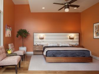 Orange Master Bedroom With Custom Platform Bed