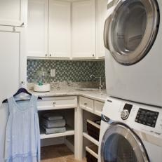 mosaic backsplash in small laundry room