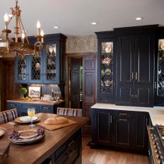 Distressed Black Cabinets Add Drama to Traditional Kitchen