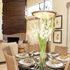 Contemporary Dining Room With Tall Floral Centerpiece