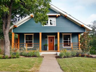 Blue Farmhouse With Wood Porch Beams