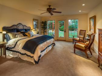 Traditional Master Bedroom With Patio Access
