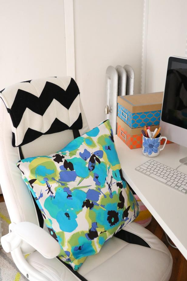 Use this bold and colorful pillow to add some summer style to your office space.