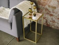 Make a gold end table on a budget by using square wood dowels and gold spray paint.