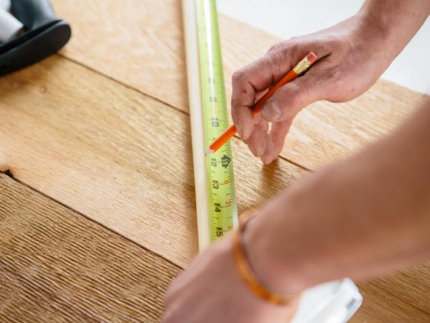 Measure wood dowels to make a coffee table.