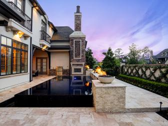 Outdoor Kitchen and Patio With Black Stone Infinity Pool