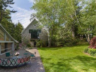 Idyllic Outdoor Grounds Wrap Around Historic Stone House