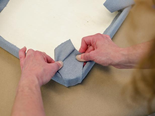 Create tailored corners by pulling the fabric tightly before gluing.