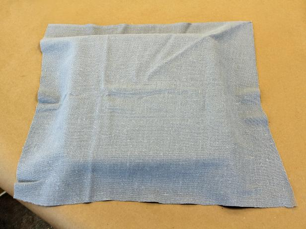 Cut fabric just a bit larger than the bottom of the tray.