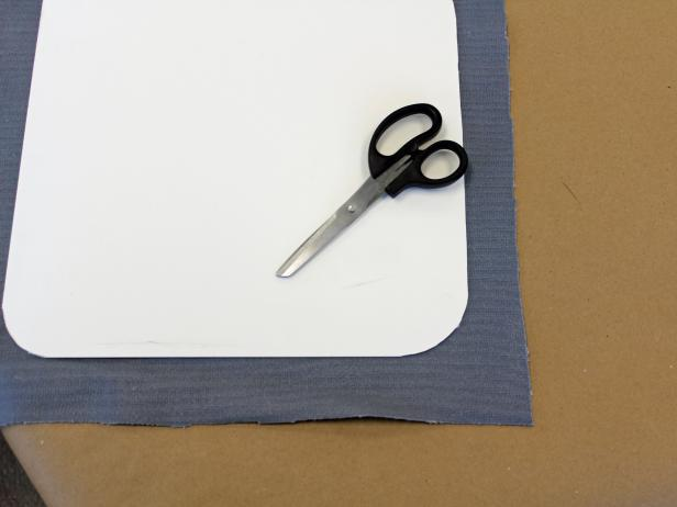 Cut fabric for tray liner just a bit larger than the insert.