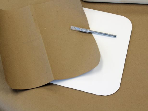 Using Kraft paper and foamcore to create templates for fabric-covered tray.
