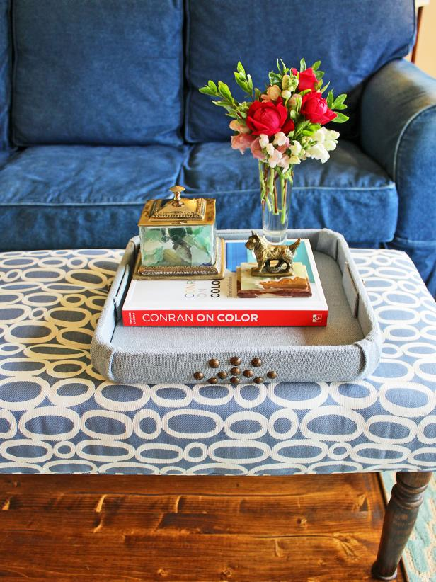 Covering a plain or dated tray with fabric is an easy way to tie it in with your decor. Your trendy new tray can then be used to corral coffee table necessities or as a cocktail tray when entertaining.