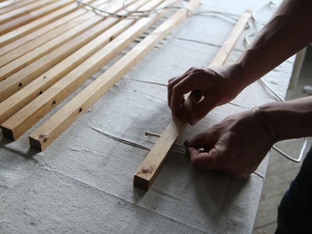 Slide rope through pre-drilled holes in the wood dowel to make a stylish doormat.