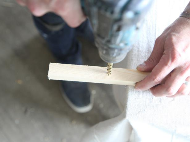 Drill holes in wood dowels to make a stylish doormat.
