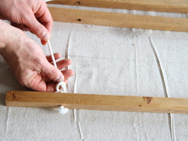 Tie a knot in the rope between each wood dowel to make a stylish doormat.