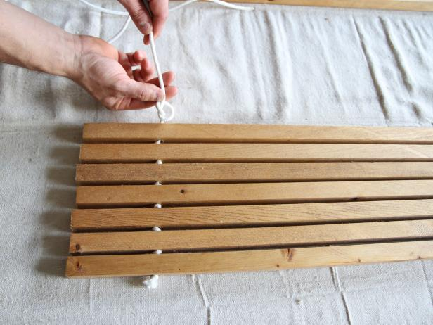 Tie a knot between each wood dowel to make a stylish doormat.