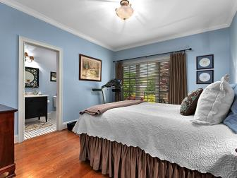 Cool Blue Bedroom With Brown Accents & Adjacent Bathroom