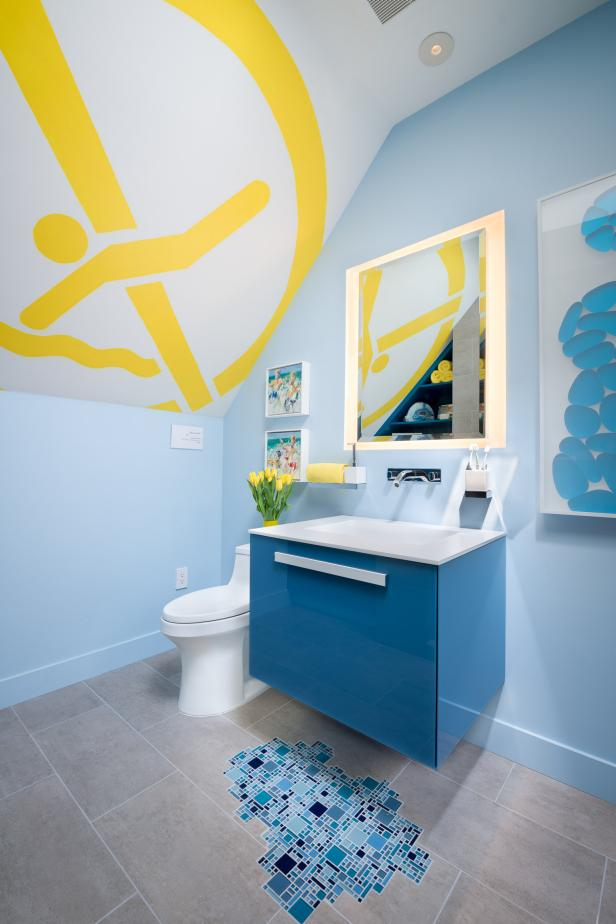 Boy's Bathroom Invokes Swimming Pool Theme With Blue Vanity and Mosaic Tile