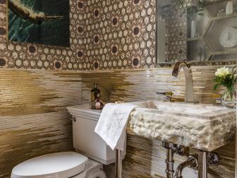 Powder Room Features Silk Fabric Wallcovering and Gold and Onyx Mosaic Tile