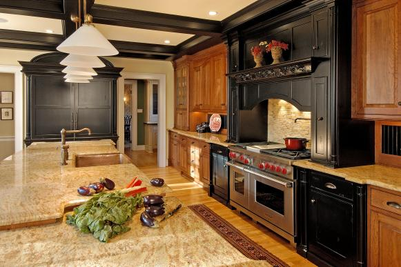 Kitchen With Wood Cabinetry, Ample Counter Space & Paneled Refrigerator