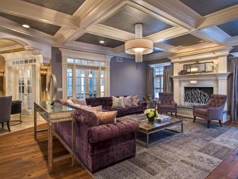Beautiful Contemporary Living Room With Violet Velvet Sofa, Lavender Details and Coffered Ceiling