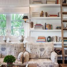Armchair With Newsprint Pattern and Bookshelf