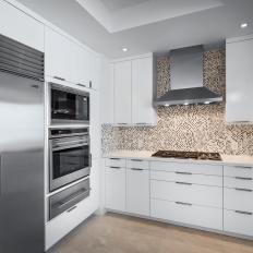 White Modern Kitchen With Mosaic Tile Backsplash